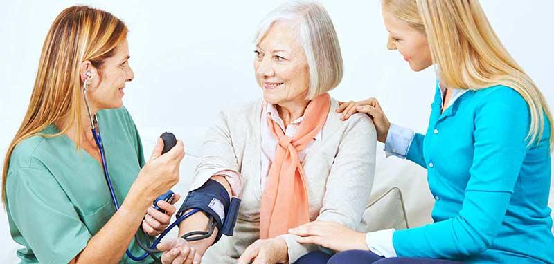 nurse taking blood pressure